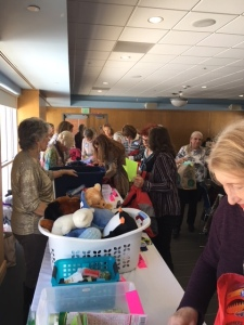 Guests help fill backpacks for Restore Innocence
